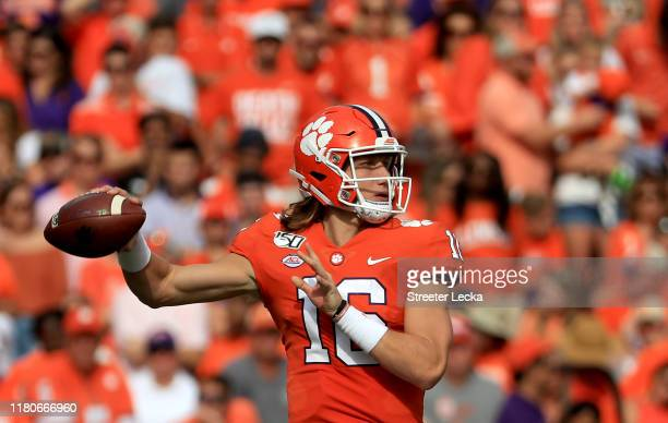 Trevor Lawrence of the Clemson Tigers drops back to pass againstthe Florida State Seminoles during their game at Memorial Stadium on October 12, 2019...