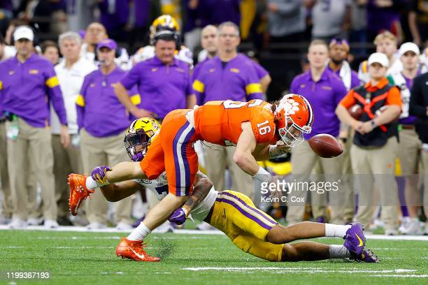 Trevor Lawrence of the Clemson Tigers fumbles the ball against the LSU Tigers during the fourth quarter in the College Football Playoff National...