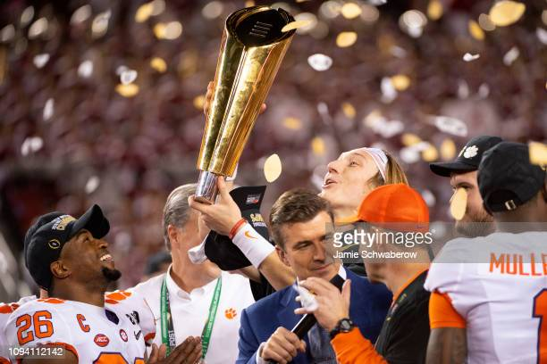 Trevor Lawrence of the Clemson Tigers hold the trophy after defeating the Alabama Crimson Tide during the College Football Playoff National...