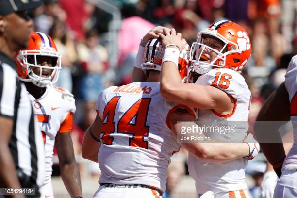 Trevor Lawrence of the Clemson Tigers hugs Garrett Williams after he rushed for a two-yard touchdown in the second quarter of the game against the...