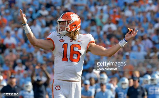 Trevor Lawrence of the Clemson Tigers looks to the sideline during the first half of their game against the North Carolina Tar Heels at Kenan Stadium...