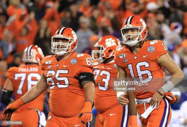 Trevor Lawrence of the Clemson Tigers reacts after a touchdown against the Virginia Cavaliers during the ACC Football Championship game at Bank of...