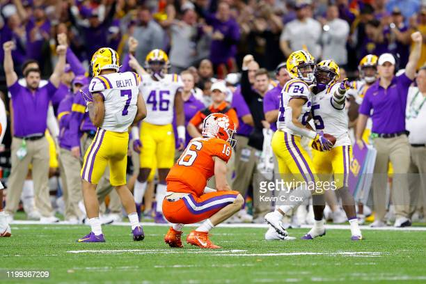 Trevor Lawrence of the Clemson Tigers reacts after fumbling the ball against the LSU Tigers during the fourth quarter in the College Football Playoff...