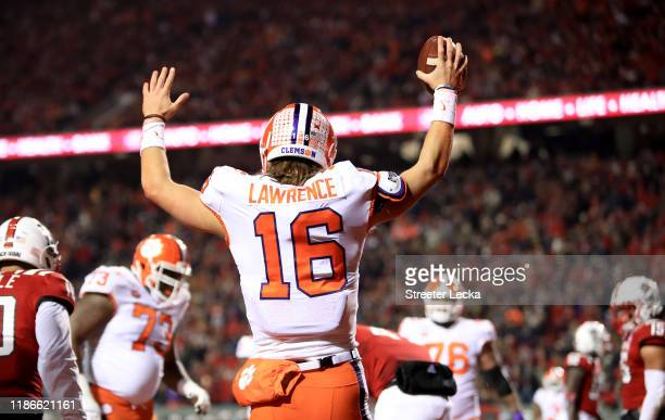 Trevor Lawrence of the Clemson Tigers reacts after scoring a touchdown against the North Carolina State Wolfpack during their game at CarterFinley...