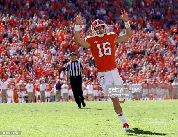 Trevor Lawrence of the Clemson Tigers reacts after throwing a touchdown pass against the Louisville Cardinals during their game at Clemson Memorial...