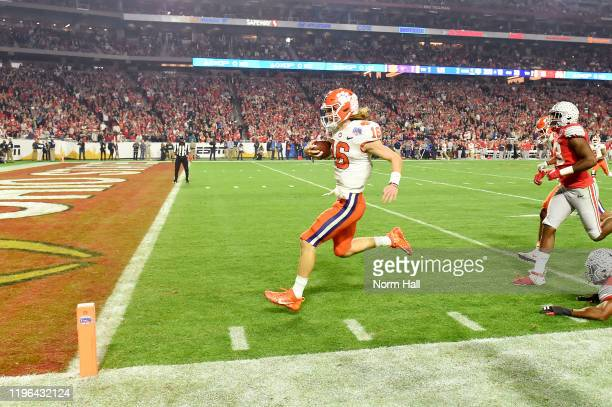 Trevor Lawrence of the Clemson Tigers runs the ball for a 67-yard rushing touchdown against the Ohio State Buckeyes in the first half during the...