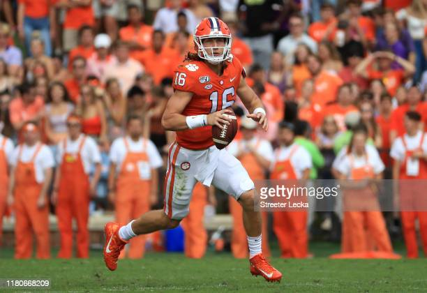 Trevor Lawrence of the Clemson Tigers runs with the ball against the Florida State Seminoles during their game at Memorial Stadium on October 12,...