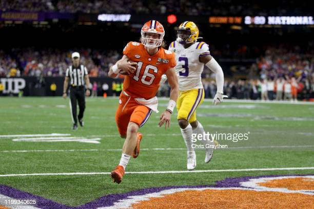 Trevor Lawrence of the Clemson Tigers scores a touchdown against the LSU Tigers in the College Football Playoff National Championship game at...