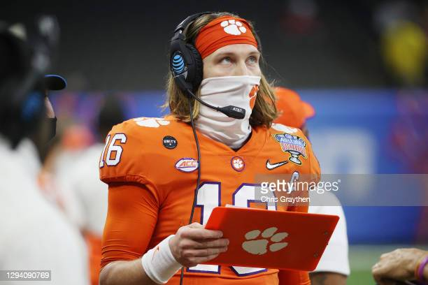 Trevor Lawrence of the Clemson Tigers stands on the sideline in the first half against the Ohio State Buckeyes during the College Football Playoff...