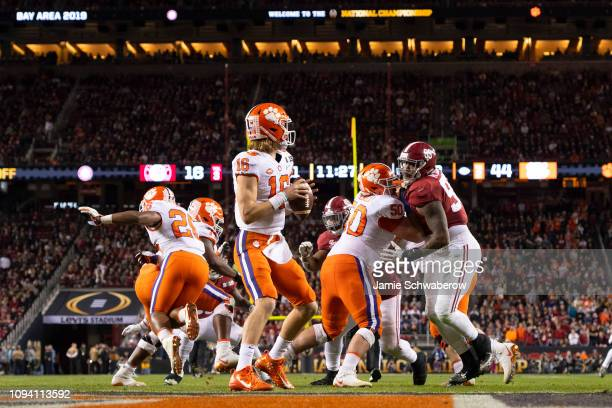 Trevor Lawrence of the Clemson Tigers takes the snap against the Alabama Crimson Tide during the College Football Playoff National Championship held...