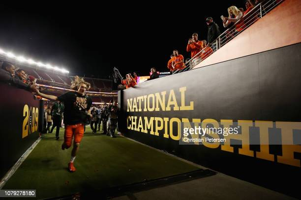 Trevor Lawrence of the Clemson Tigers walks off the field after his teams 44-16 win over the Alabama Crimson Tide in the CFP National Championship...
