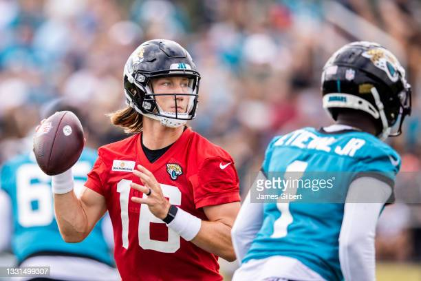 Trevor Lawrence of the Jacksonville Jaguars looks to pass during Training Camp at TIAA Bank Field on July 30, 2021 in Jacksonville, Florida.