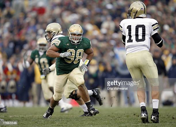 Trevor Laws of the Notre Dame Fighting Irish moves to sack Carson Williams of the Army Black Knights at Notre Dame Stadium on November 18 2006 in...