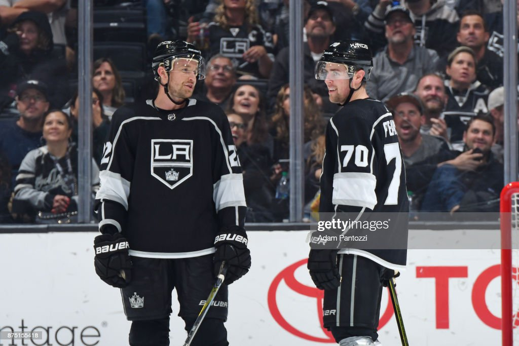 Trevor Lewis #22 and Tanner Pearson #70 of the Los Angeles Kings converse during a game against the Boston Bruins at STAPLES Center on November 16, 2017 in Los Angeles, California.