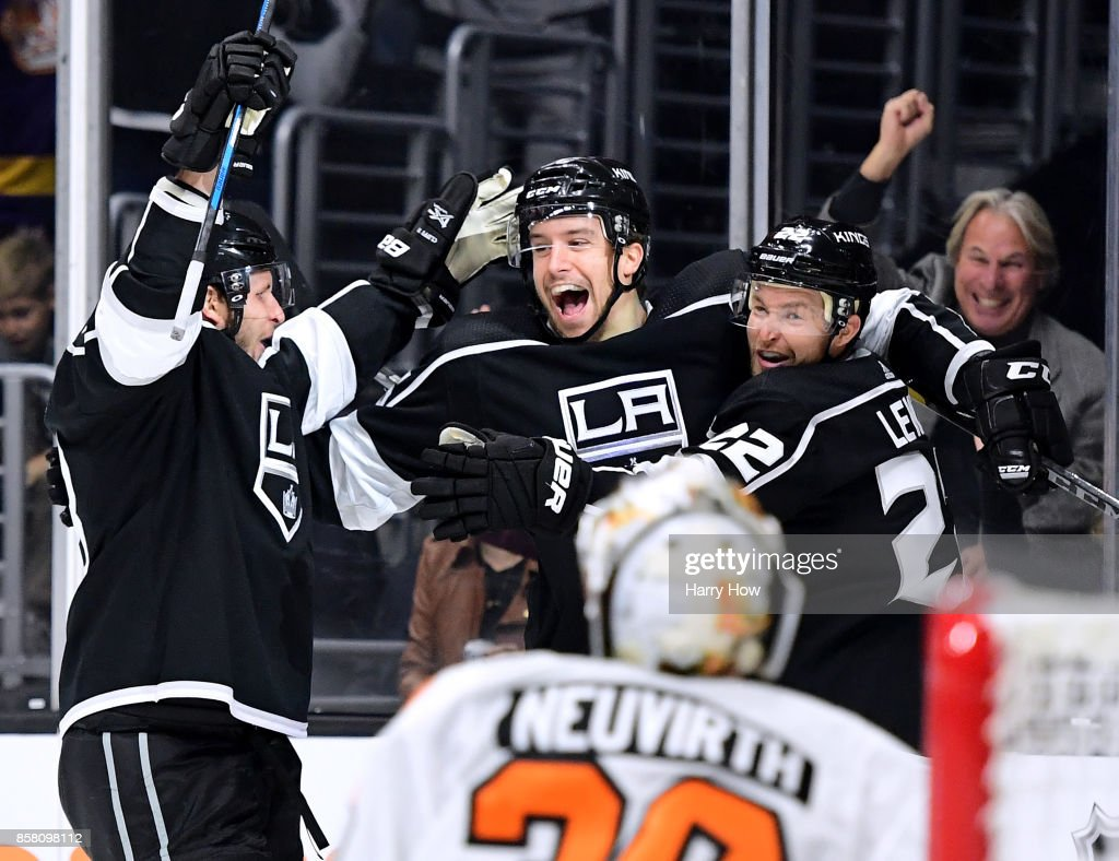 Trevor Lewis #22 celebrates his goal with Kurtis MacDermid #56 and Kyle Clifford #13 iin front of Michal Neuvirth #30 of the Philadelphia Flyers to take a 1-0 lead during the second peroid of opening night of the Los Angeles Kings 2017-2018 season at Staples Center on October 5, 2017 in Los Angeles, California.