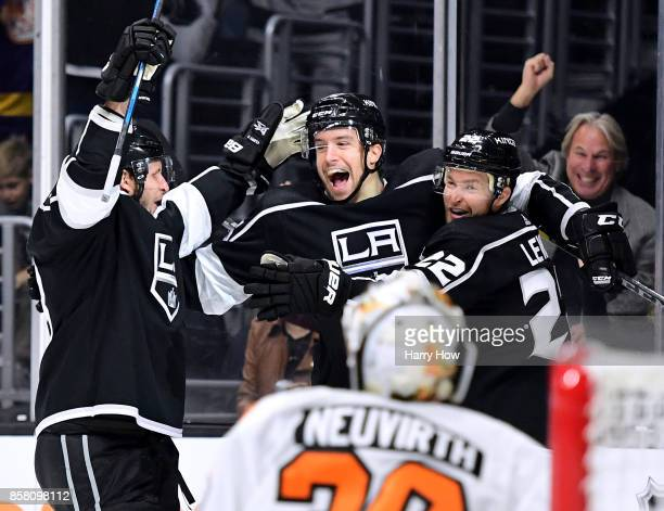 Trevor Lewis celebrates his goal with Kurtis MacDermid and Kyle Clifford iin front of Michal Neuvirth of the Philadelphia Flyers to take a 10 lead...