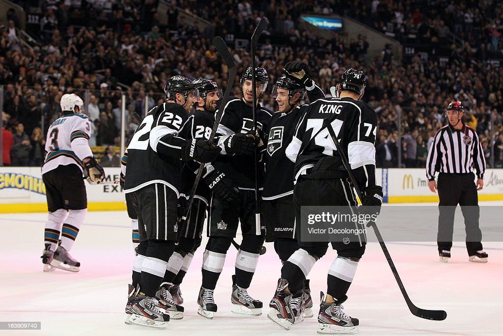 Trevor Lewis #22, Jarret Stoll #28, Keaton Ellerby #5, Alec Martinez #27 and Dwight King #74 of the Los Angeles Kings celebrate King's goal in the second period against the San Jose Sharks during the NHL game at Staples Center on March 16, 2013 in Los Angeles, California. The Kings defeated the Sharks 5-2.