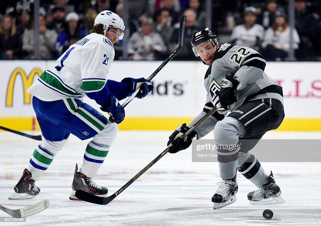 Trevor Lewis #22 of the Los Angeles Kings and Loui Eriksson #21 of the Vancouver Canucks skate for the puck at Staples Center on October 22, 2016 in Los Angeles, California.