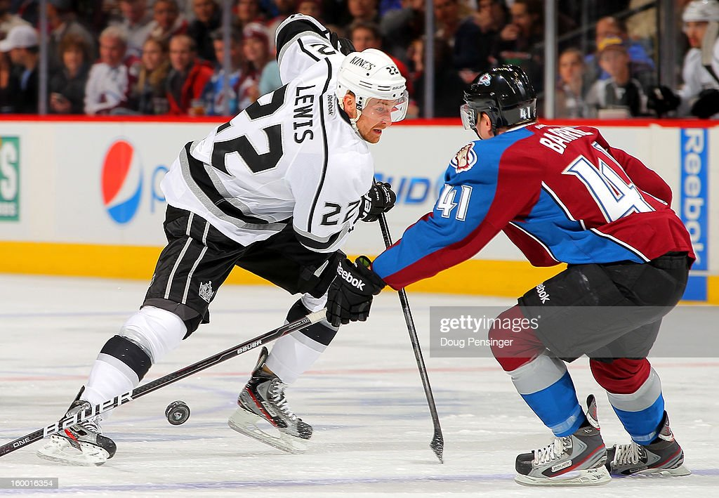 Trevor Lewis #22 of the Los Angeles Kings and Tyson Barrie #41 of the Colorado Avalanche vie for control of the puck at the Pepsi Center on January 22, 2013 in Denver, Colorado. The Avalanche defeated the Kings 3-1.