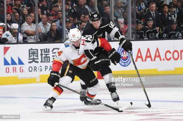 Trevor Lewis of the Los Angeles Kings battles for the puck against Matt Bartkowski of the Calgary Flames at STAPLES Center on October 11 2017 in Los...