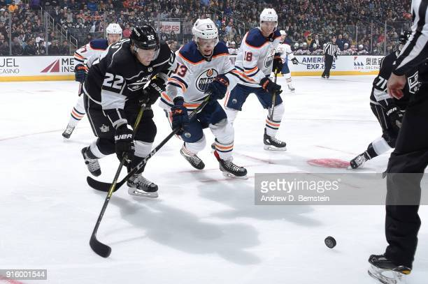 Trevor Lewis of the Los Angeles Kings battles for the puck against Michael Cammalleri of the Edmonton Oilers at STAPLES Center on February 7 2018 in...