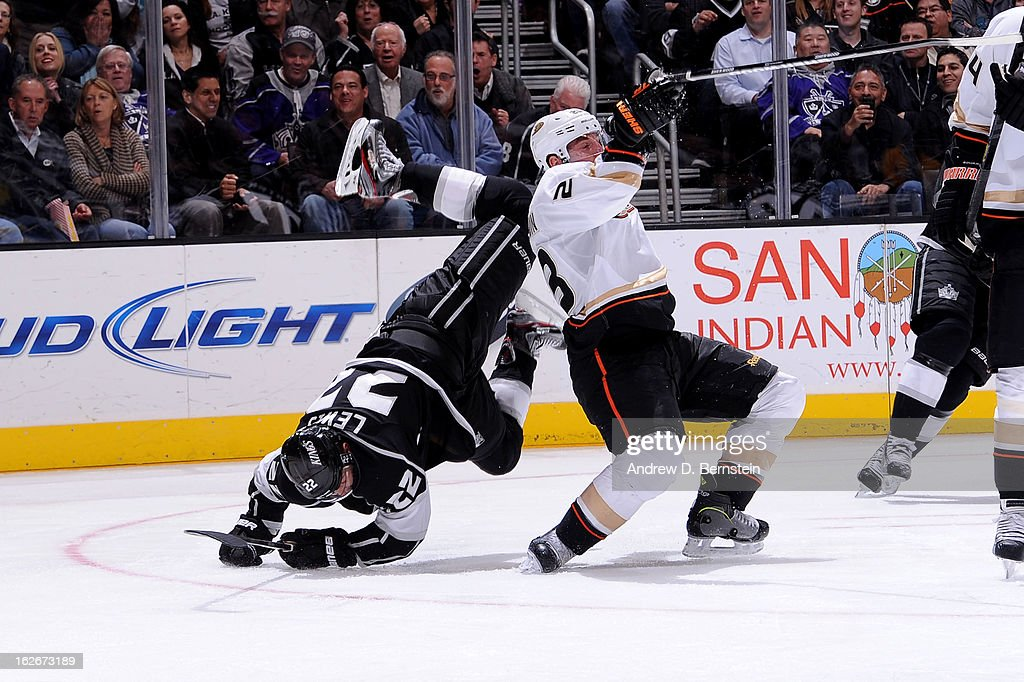 Trevor Lewis #22 of the Los Angeles Kings collides with Francois Beauchemin #23 of the Anaheim Ducks at Staples Center on February 25, 2013 in Los Angeles, California.