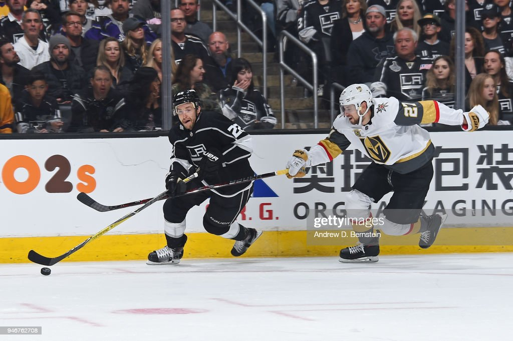 Trevor Lewis #22 of the Los Angeles Kings handles the puck against Shea Theodore #27 of the Vegas Golden Knights in Game Three of the Western Conference First Round during the 2018 NHL Stanley Cup Playoffs at STAPLES Center on April 15, 2018 in Los Angeles, California.