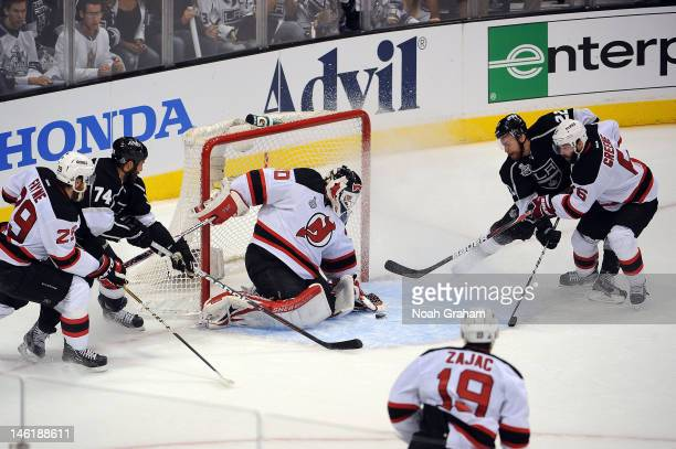 Trevor Lewis of the Los Angeles Kings scores a goal against Martin Brodeur of the New Jersey Devils in Game Six of the 2012 Stanley Cup Final at...