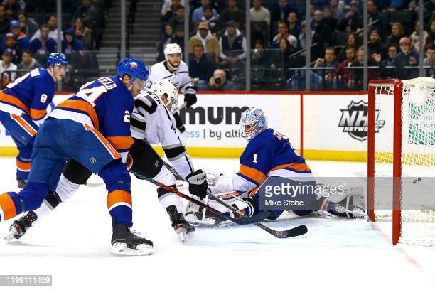 Trevor Lewis of the Los Angeles Kings scores a goal past Thomas Greiss of the New York Islanders during the second period at Barclays Center on...