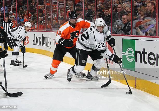 Trevor Lewis skates the puck with teammate Dustin Brown of the Los Angeles Kings against Radko Gudas of the Philadelphia Flyers on November 17 2015...
