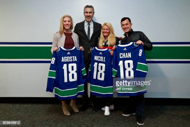 Trevor Linden gives Canucks jerseys to Canadian olympic athletes Meghan Agosta Patrick Chan and Mercedes Nicoll during the NHL game between the...