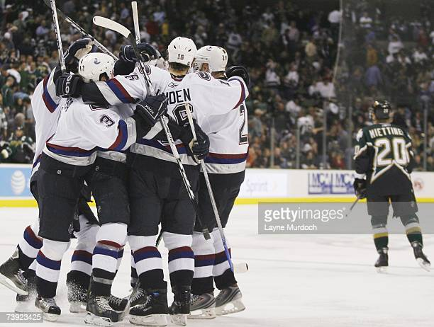Trevor Linden of the Vancouver Canucks and his teammates celebrate as Antti Miettinen of the Dallas Stars skates away during game three of the 2007...