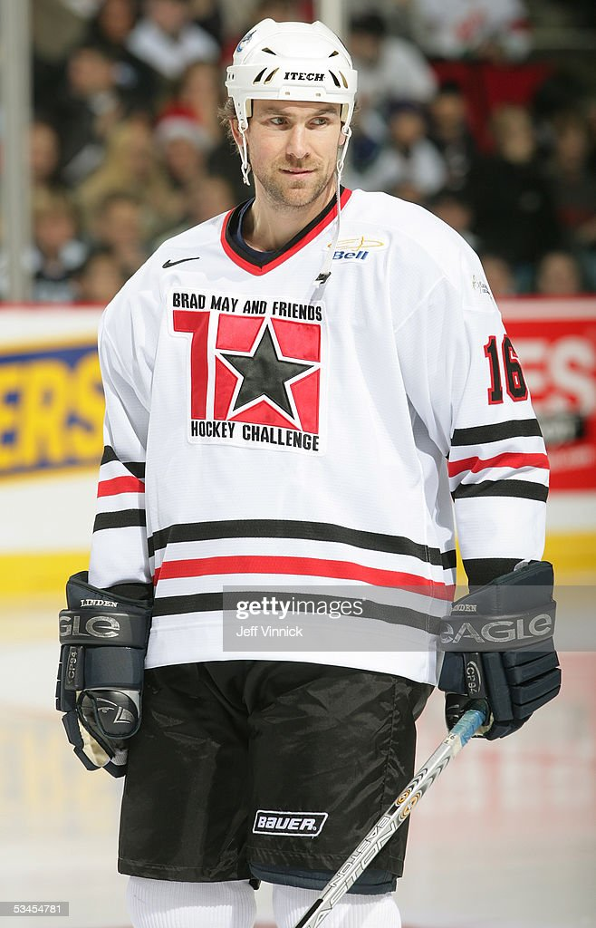 Trevor Linden #16 of the Vancouver Canucks looks on during the Brad May and Friends Hockey Challenge at the Pacific Coliseum on December 12, 2004 in Vancouver, Canada. Players from the NHL and the WHL Vancouver Giants played two exhibition games to raise money for Canuck Place hospice in Vancouver.