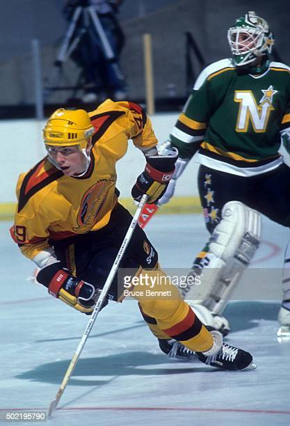 Trevor Linden of the Vancouver Canucks skates on the ice during an NHL game against the Minnesota North Stars circa 1988 at the Pacific Coliseum in...