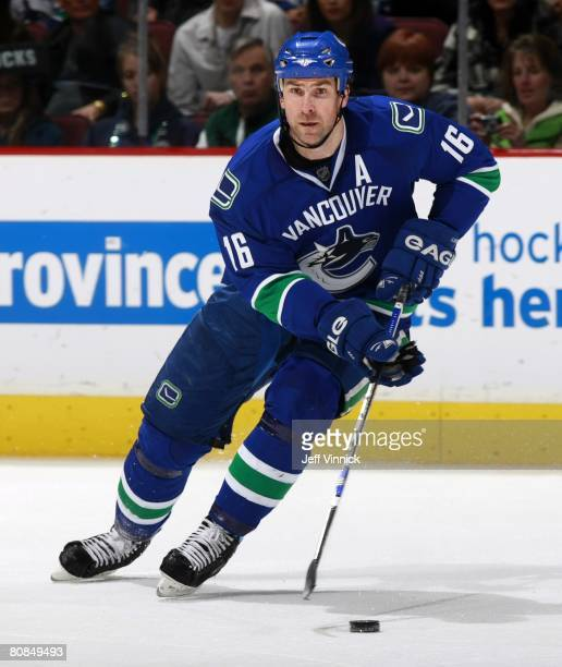 Trevor Linden of the Vancouver Canucks skates up ice with the puck during their game against the Calgary Flames at General Motors Place on April 5,...