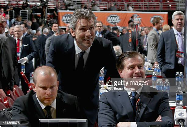 Trevor Linden President of the Vancouver Canucks Jim Benning General manager of the Vancouver Canucks and Eric Crawford Director of Player Personel...