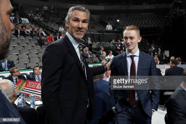 Trevor Linden talks with Tyler Madden reacts after being selected 68th overall by the Vancouver Canucks during the 2018 NHL Draft at American...