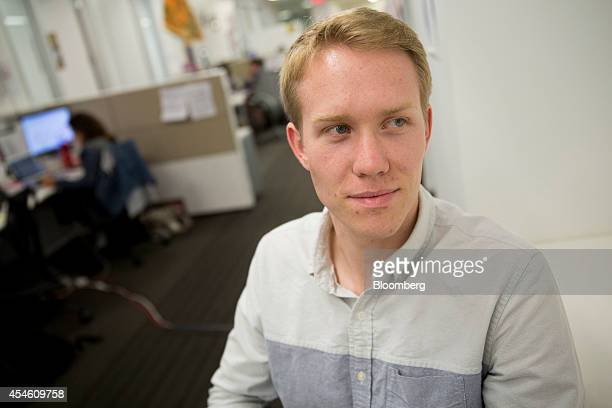 Trevor Lynn chief marketing officer at Social Tables Inc sits for a photograph at the company's headquarters in Washington DC US on Thursday Aug 14...