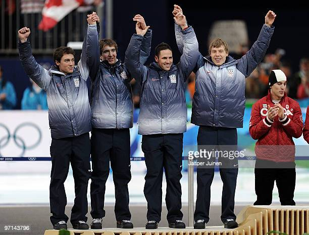 Trevor Marsicano Jonathan Kuck Chad Hedrick and Brian Hansen of the United States receive the silver medal during the medal ceremony for the men's...