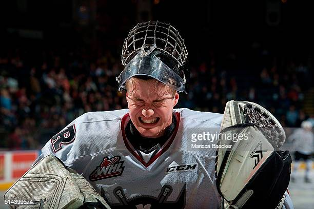 Trevor Martin of Red Deer Rebels squeezes sweat from his eyes against the Kelowna Rockets on February 16 2016 at Prospera Place in Kelowna British...
