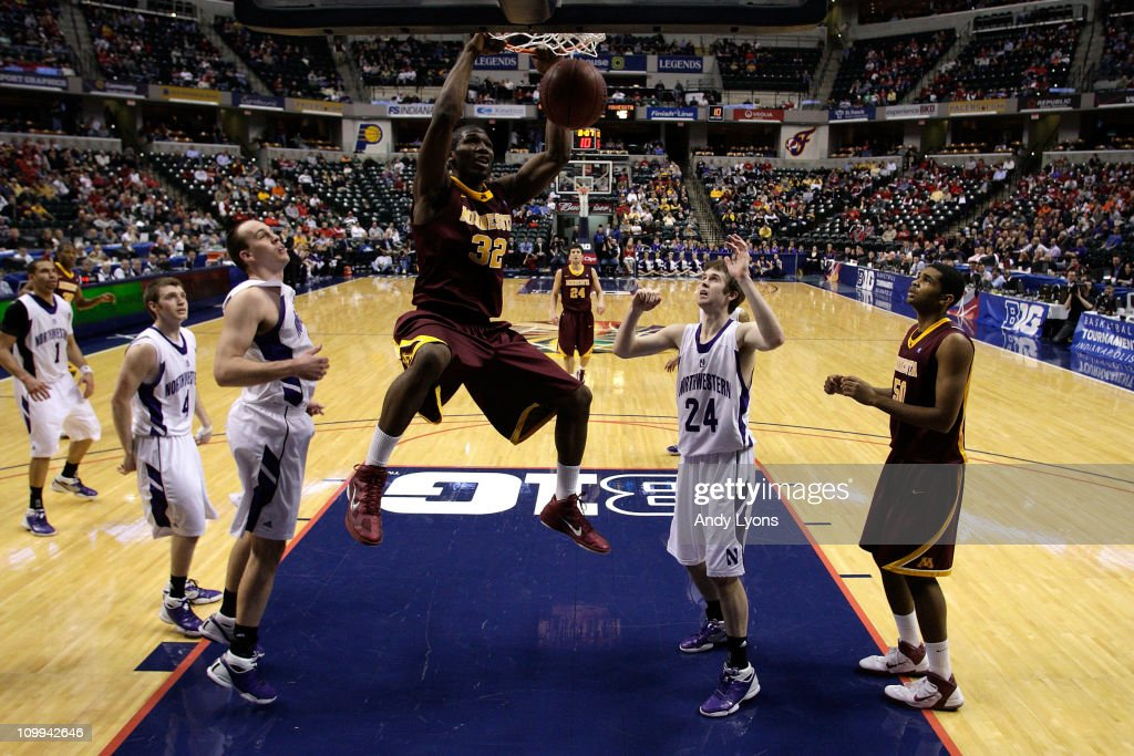 Trevor Mbakwe #32 of the Minnesota Golden Gophers dunks against John Shurna #24 of the Northwestern Wildcats during the first round of the 2011 Big Ten Men's Basketball Tournament at Conseco Fieldhouse on March 10, 2011 in Indianapolis, Indiana.