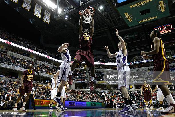 Trevor Mbakwe of the Minnesota Golden Gophers dunks against the Northwestern Wildcats during the first round of the 2011 Big Ten Men's Basketball...