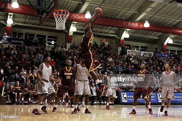 Trevor Mbakwe of the Minnesota Golden Gophers dunks in the second half against the St Joseph's Hawks at Michael J Hagan Arena on December 8 2010 in...