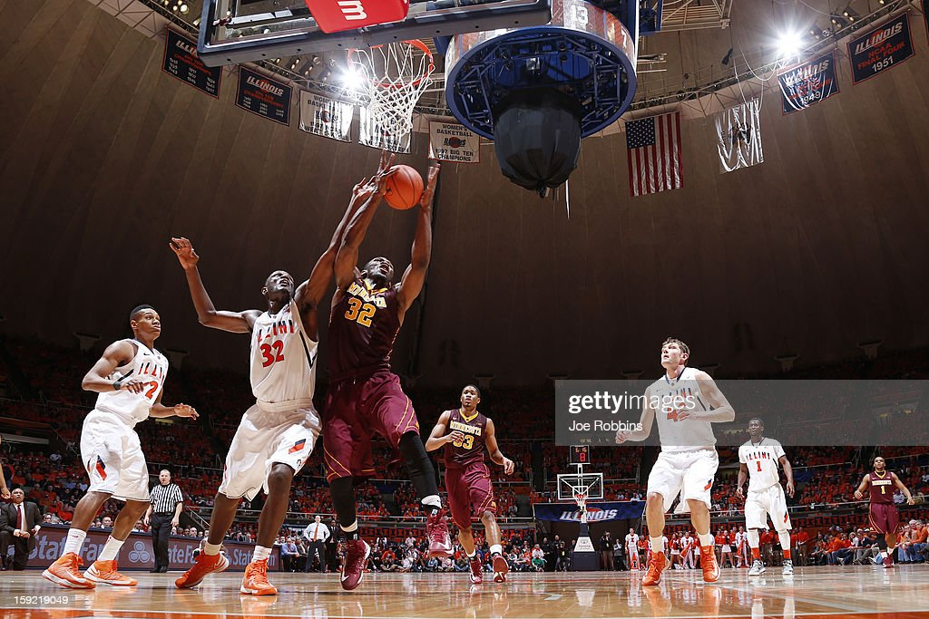 Trevor Mbakwe #32 of the Minnesota Golden Gophers rebounds against Nnanna Egwu #32 of the Illinois Fighting Illini during the game at Assembly Hall on January 9, 2013 in Champaign, Illinois. Minnesota won 84-67.