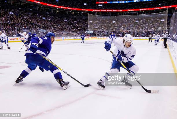 Trevor Moore of the Toronto Maple Leafs plays the puck against Ryan McDonagh of the Tampa Bay Lightning during the second period at the Scotiabank...