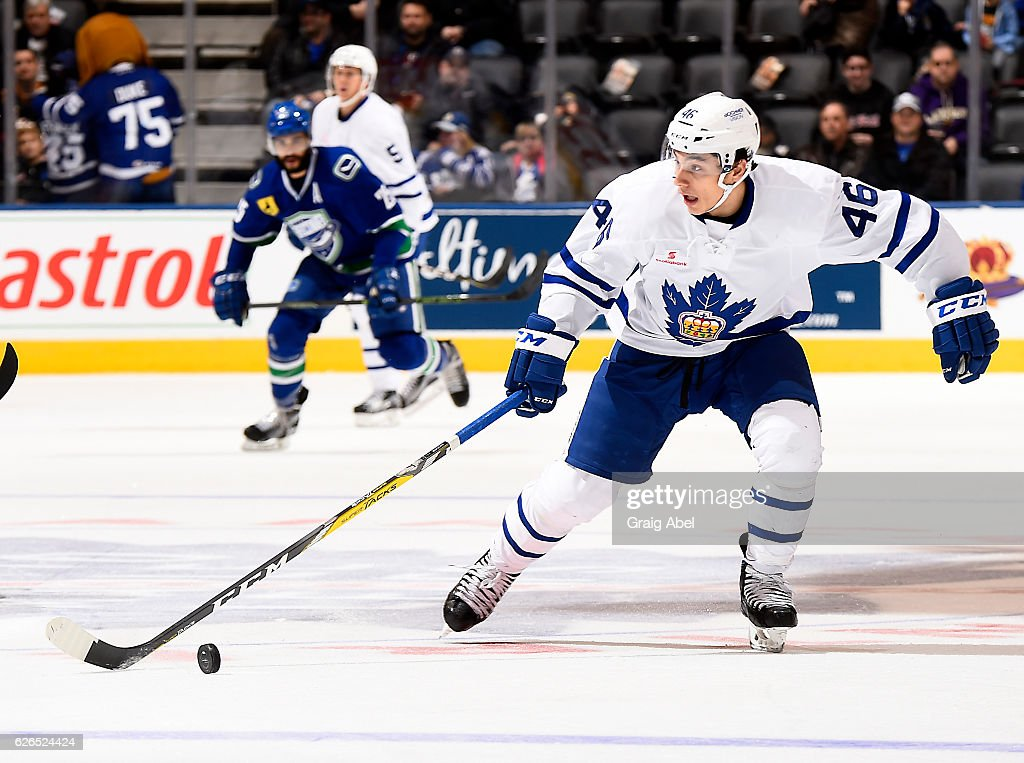 Trevor Moore #46 of the Toronto Marlies controls the puck up ice against the Utica Comets during game action on November 26, 2016 at Air Canada Centre in Toronto, Ontario, Canada.