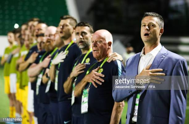 Trevor Morgan, head coach of Australia stands for the national anthem before the match against France for the FIFA U-17 World Cup Brazil 2019 on...