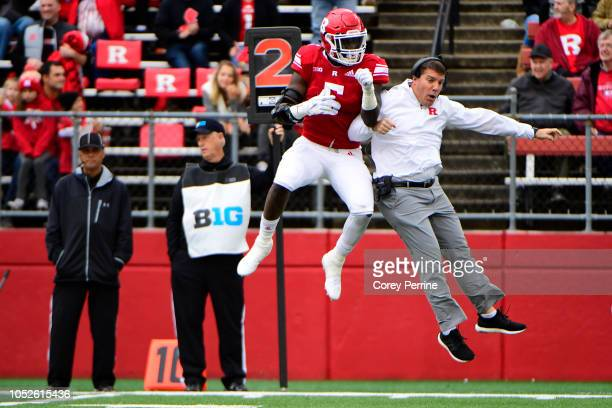 Trevor Morris of the Rutgers Scarlet Knights celebrates with Head coach Chris Ash after a safety is scored against the Northwestern Wildcats during...