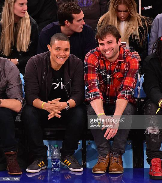 Trevor Noah and guest attend the Boston Celtics vs New York Knicks game at Madison Square Garden on October 16 2015 in New York City