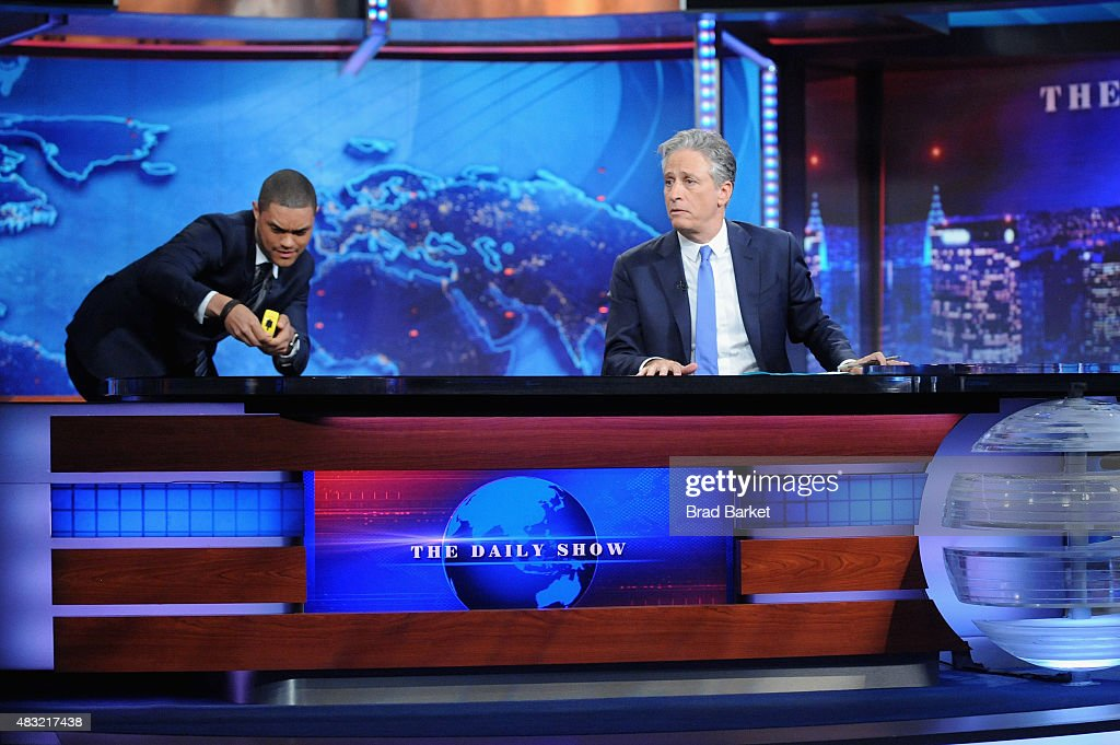 Trevor Noah and host Jon Stewart appear on 'The Daily Show with Jon Stewart' #JonVoyage on August 6, 2015 in New York City.